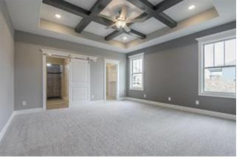 Master bedroom and master bath in a Drippé Homes built house